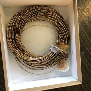 Coldwater Creek Gold bangles with seashells